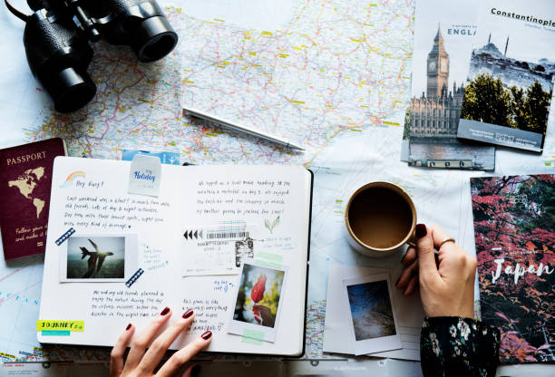 trip planning with map - travel imagens e fotografias de stock