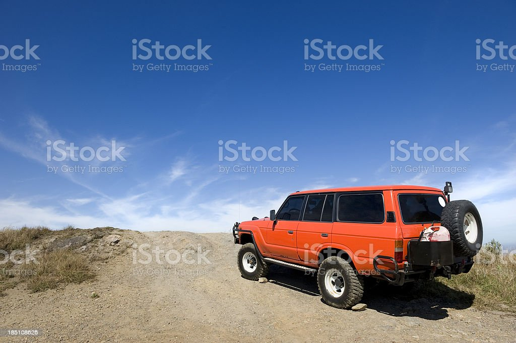 rustic vehicle parked at the top of the mountain at the height of the...