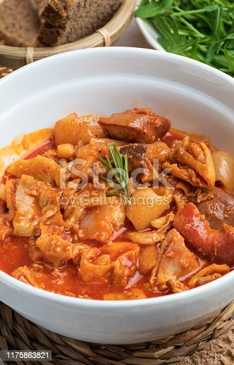 Tripes in clay pot. Top view. Rustic appearance. (Callos a la Madrileña).