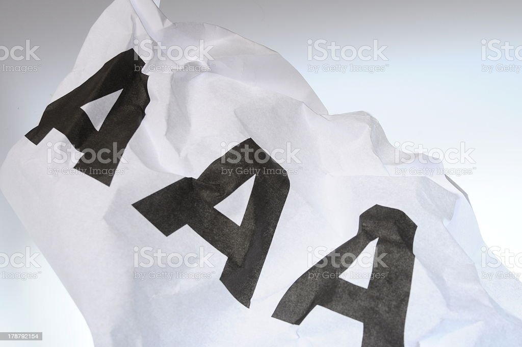 Triple A on crumpled paper royalty-free stock photo