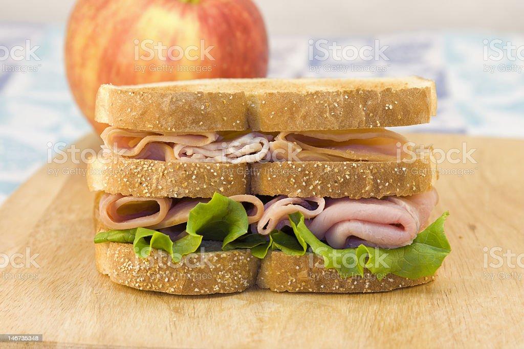 triple decker sandwich on cutting board royalty-free stock photo