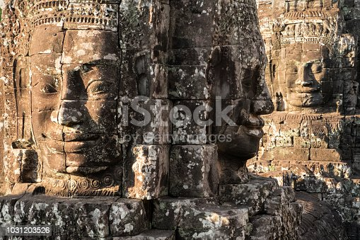 Three faces of Buddha at Bayon Temple, Cambodia in color.