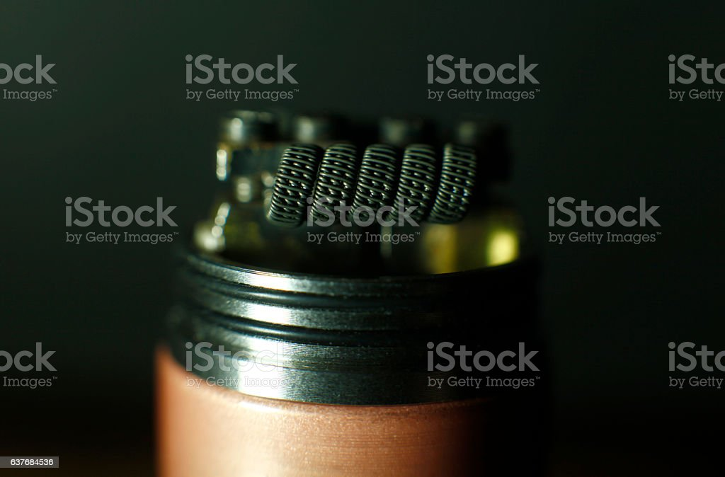 Triple fused clapton coil build in vaping rebuildable dripping atomizer stock photo