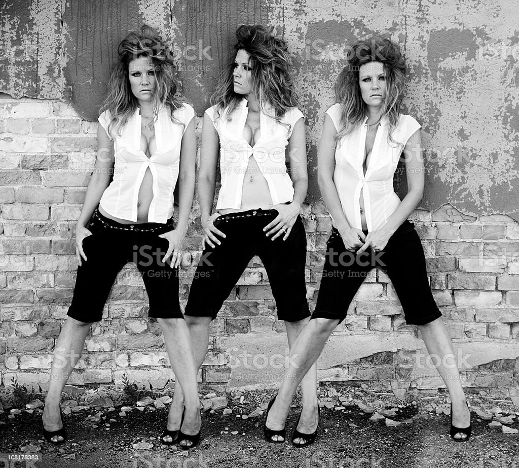 Triple Shots of Woman Posing Against Cement Wall stock photo