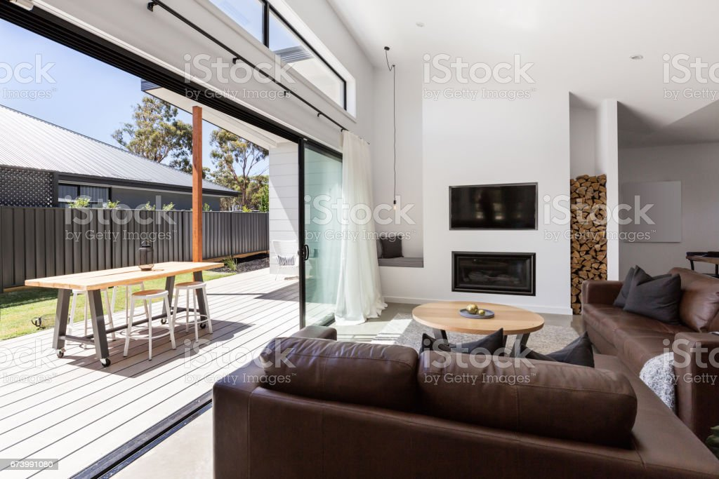 Triple sliding back glass doors from living room to outdoor deck stock photo