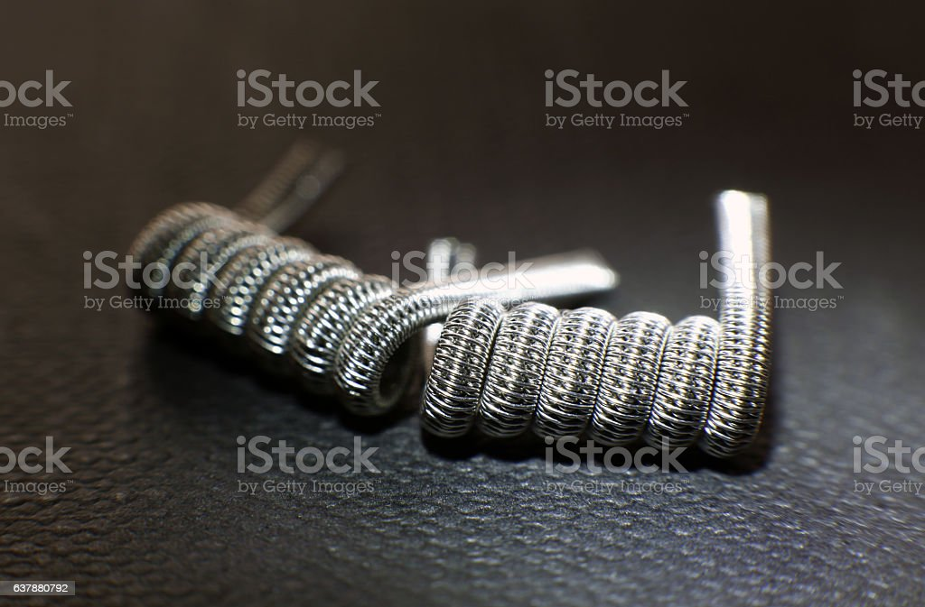 Triple staggered fused clapton coil build for vaping rebuildable atomizer stock photo