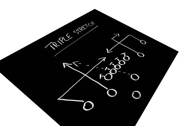 Triple stretch football play stock photo