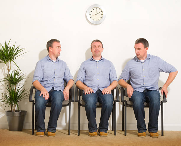triplets in a waiting room - triplets stock photos and pictures