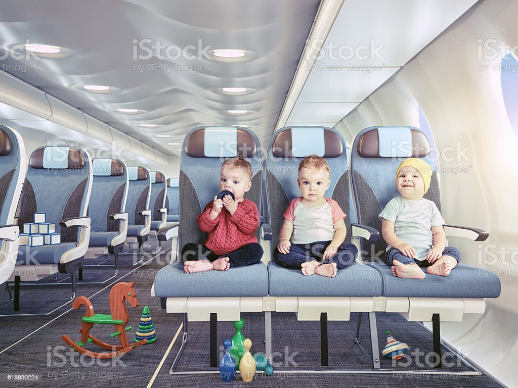 triplets in the airplane stock photo