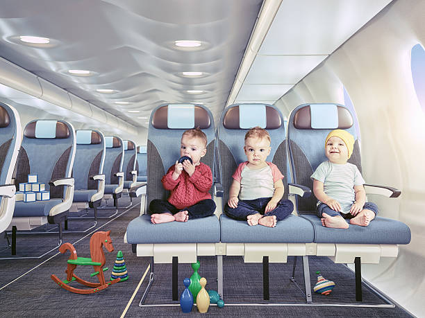 triplets in the airplane - triplets stock photos and pictures