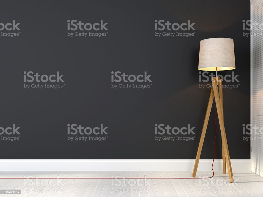 Tripod lamp with red wire stock photo