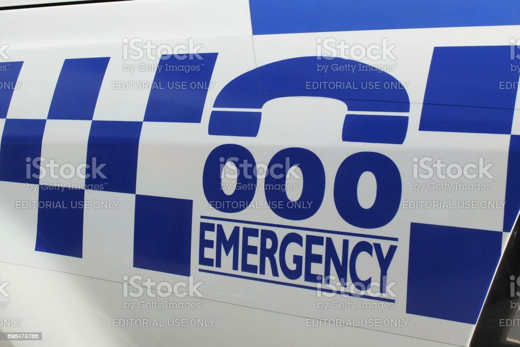 Tripple zero numbers and blue and white sign on a police car stock photo
