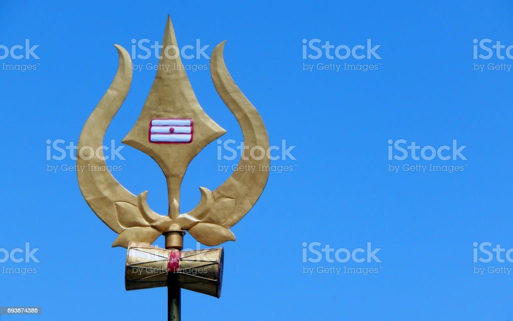 Trishul or Trident Weapon or symbol of Hindu God Shiva in a Temple stock photo