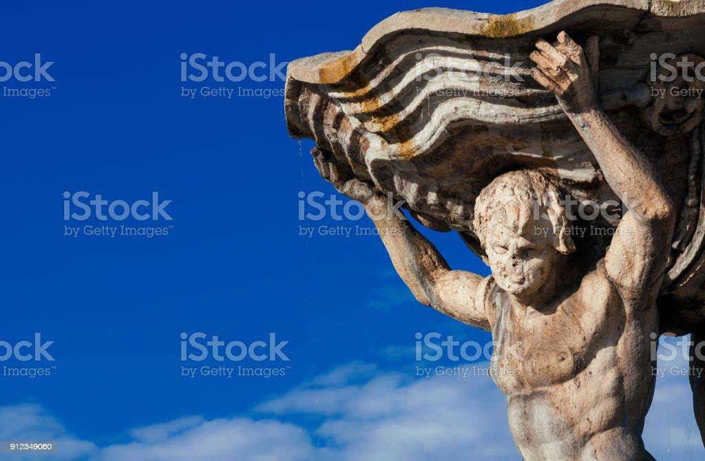 Triton statue (with copy space) stock photo