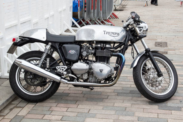 triumph motorbike at the annual classic car exhibition and vintage clothing market at kings cross, london, england - triumph foto e immagini stock