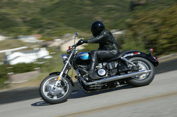 """Triumph Speedmaster pan shot """"Ventura, California USA - April 19, 2005 : Triumph Speedmaster motorcycle action shot. Triumph is a Japanese motorcycle manufacture of cruiser and sport bike motorcycles. The Shadow is one of their cruiser models."""" kawasaki heavy industries stock pictures, royalty-free photos & images"""