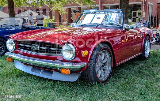 Hickory, NC, USA-7 Sept 2019: 1976 Triumph TR6 convertible, last year of production. Burgundy.  View from driver's side front.