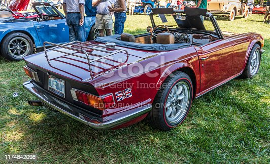 Hickory, NC, USA-7 Sept 2019: 1976 Triumph TR6 convertible, last year of production. Burgundy.  View from passenger side rear.