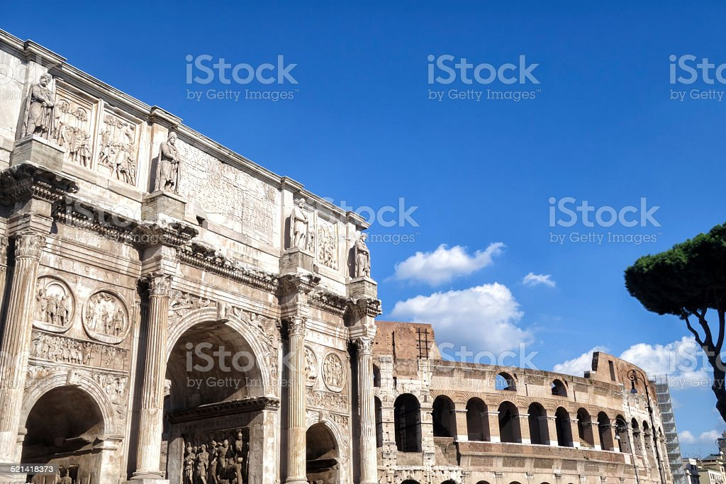 Triumphal Arch and Colosseum in Roma stock photo