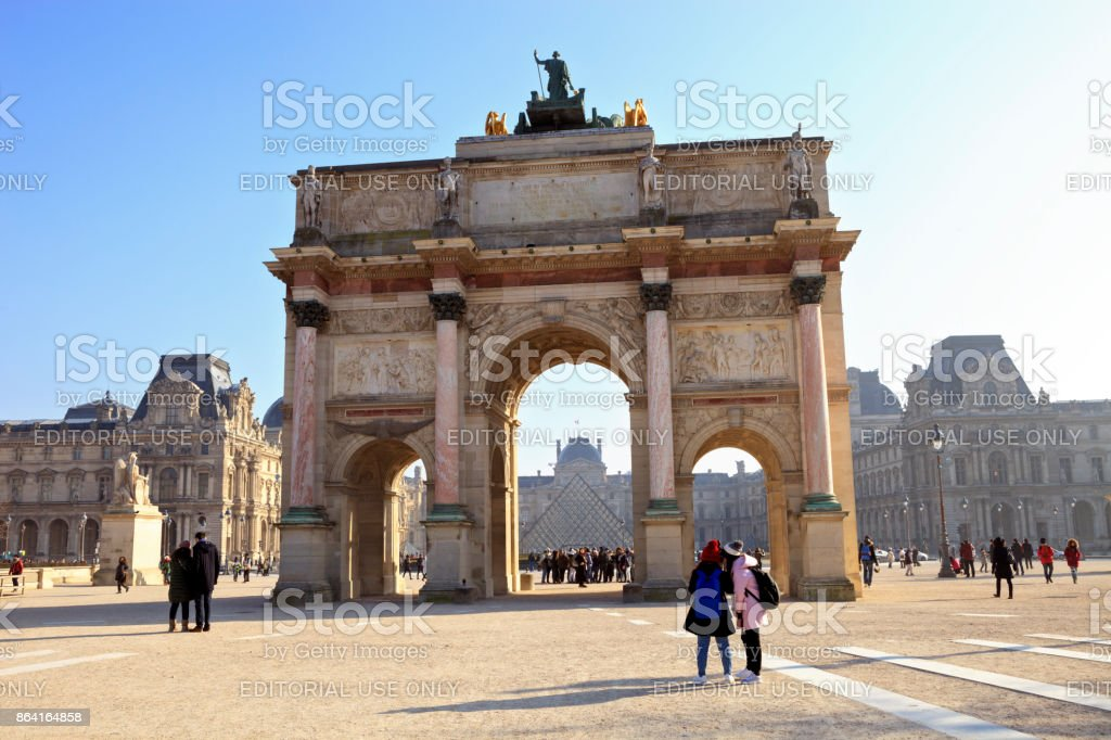 Triumphal Arch and Louvre Palace in Paris, France royalty-free stock photo