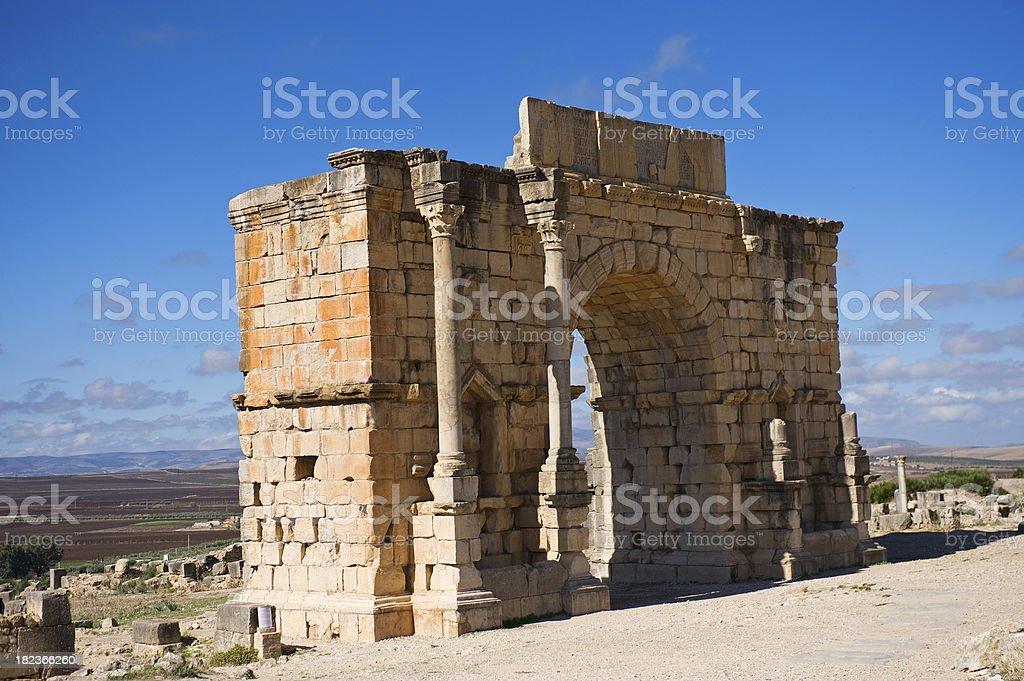 Triumphal Arch at Volubilis, Morocco stock photo