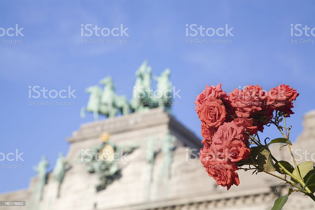 Triumphal Arch in Brussels with roses Romantic view of the Triumphal Arch (Arc de Triomphe) in the Cinquantenaire park in Brussels. Built in 1880 for the 50th anniversary of Belgium. Arch - Architectural Feature Stock Photo