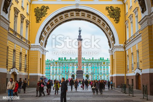 Saint Petersburg, Russia - October 1, 2017: Triumphal Arch of General Staff Building with Alexander Column, Hermitage and Palace Square with plenty of foreign tourists walk.