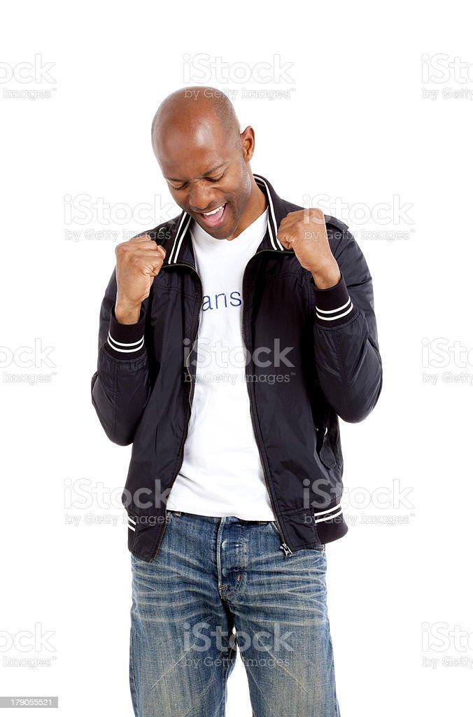 Triumphant African man in studio stock photo