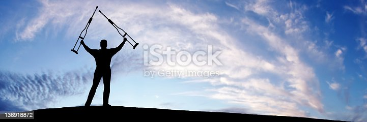 istock XL triumphant disabled man 136918872