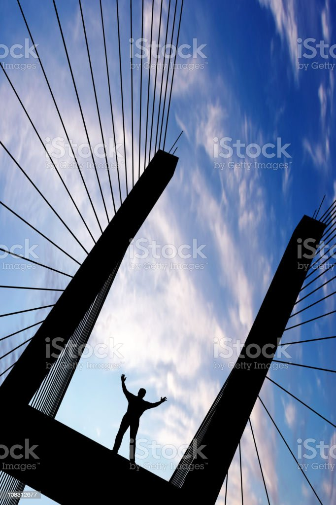 XXL triumphant man silhouette royalty-free stock photo