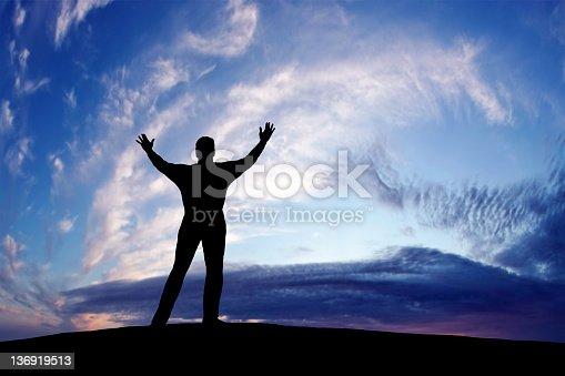 istock XXXL triumphant man silhouette 136919513