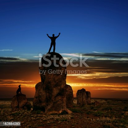 istock XXXL triumphant man silhouette 182884093