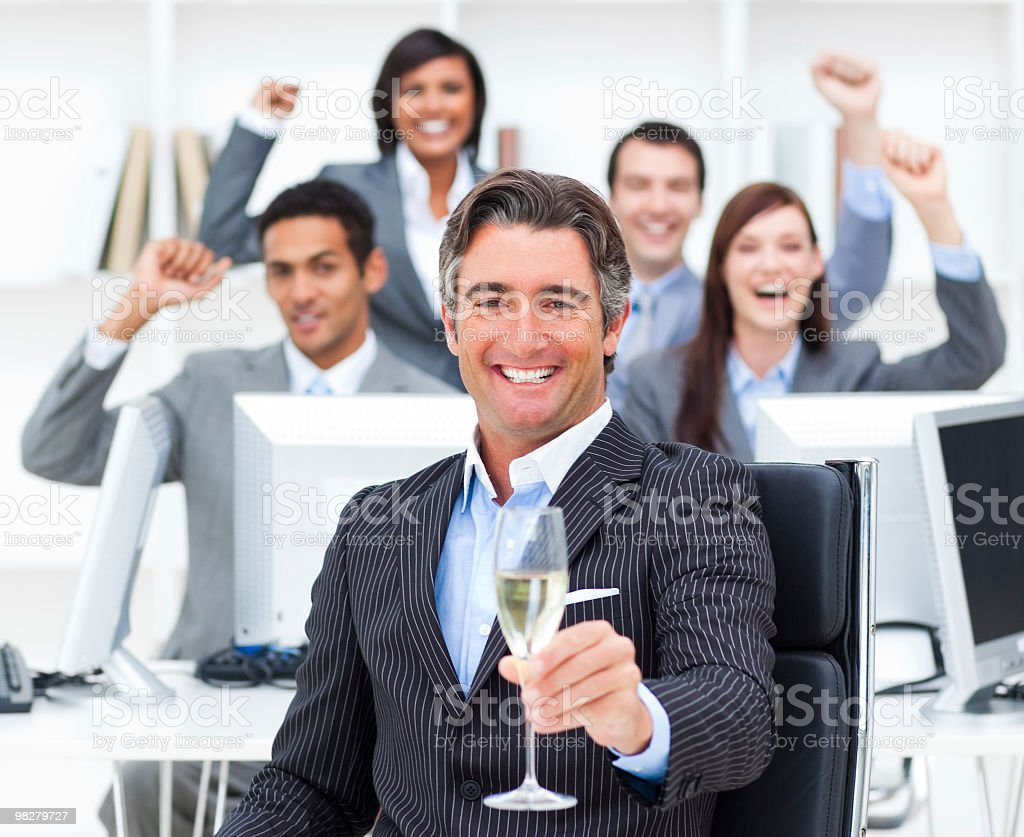 Triumphant manager and his team drinking champagne royalty-free stock photo
