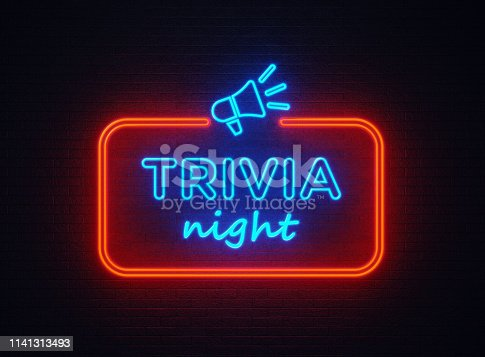 Trivia Night shaped red neon light on black wall. Horizontal composition with copy space.