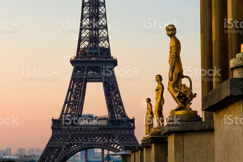 Trocadero statues with Eiffel Tower at sunrise. stock photo
