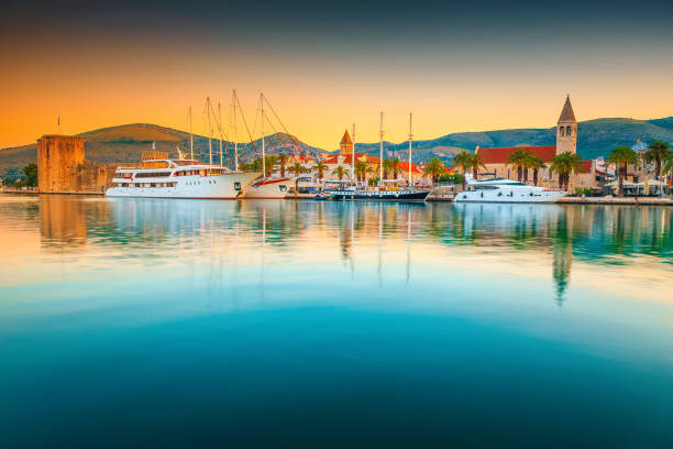 Trogir old town and harbor with boats at sunrise, Croatia stock photo