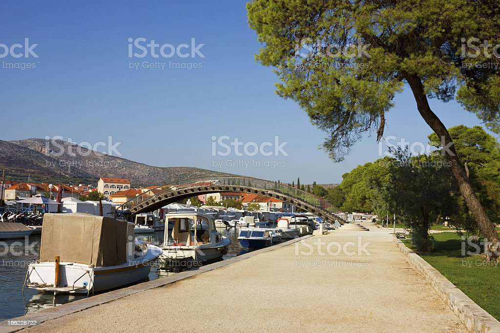 Trogir Waterfront with boats lined along the coast royalty-free stock photo