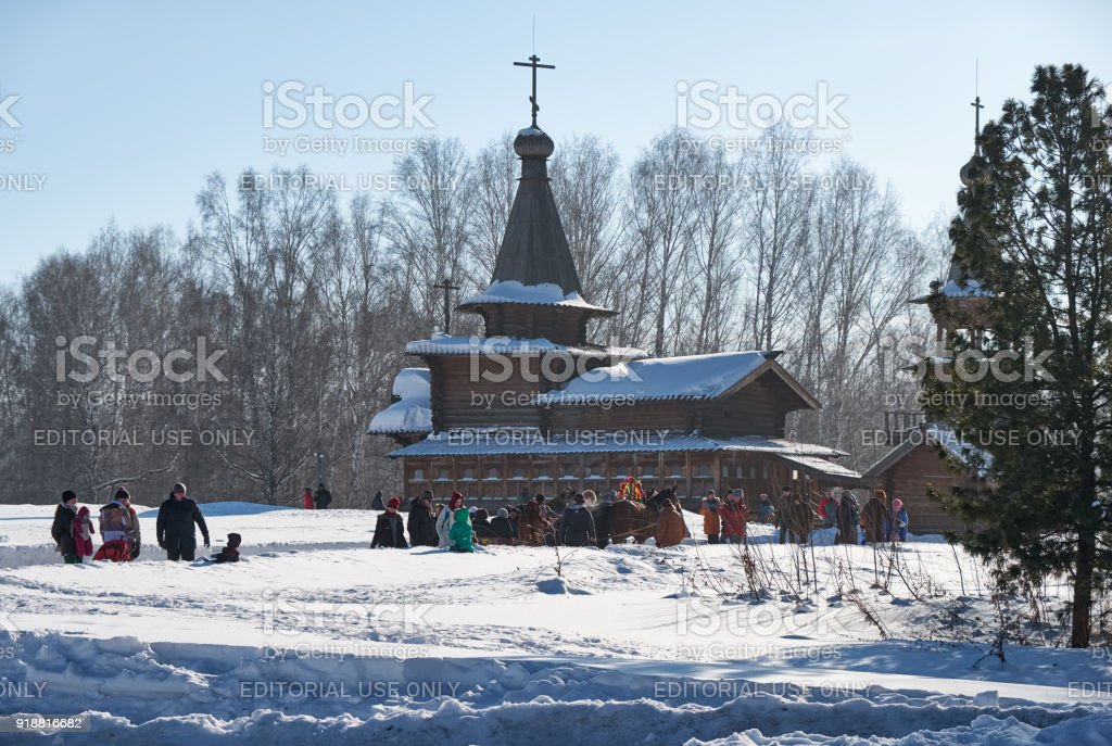 Troika of horses harnessed to a sleig. Slavonic folk late winter festivities Shrovetide or Maslenitsa in Russia. The Church of the Savior stock photo