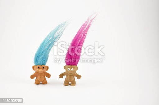 Elf on a white background. Hairy troll. Troll girl and boy figure. Troll toy images. Two trolls isolated on a white background. Couple of trolls