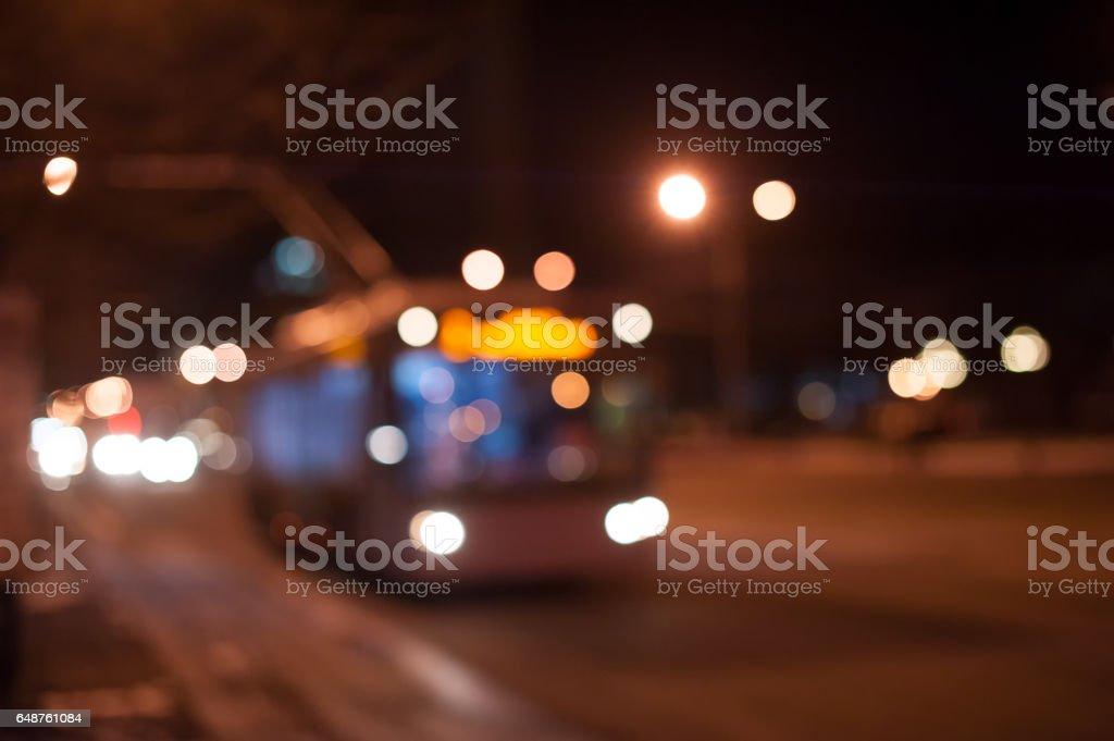 trolley bus on the night city street stock photo