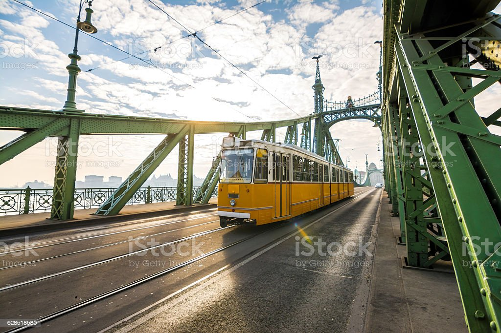 trolley car crossing liberty bridge at budapest, hungary stock photo