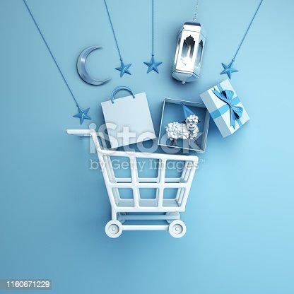 istock Trolley cart, paper bag, arabic lantern, star, gift box, sheep, crescent moon on studio lighting blue pastel background. 1160671229