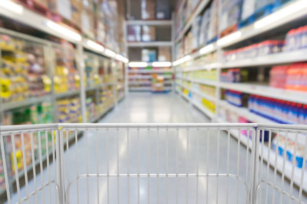 Trolley Shopping Cart in Hypermarket Trolley Shopping Cart in Hypermarket or Convenience Store Supermarket as shopping Modern lifestyle Concept. discount store stock pictures, royalty-free photos & images
