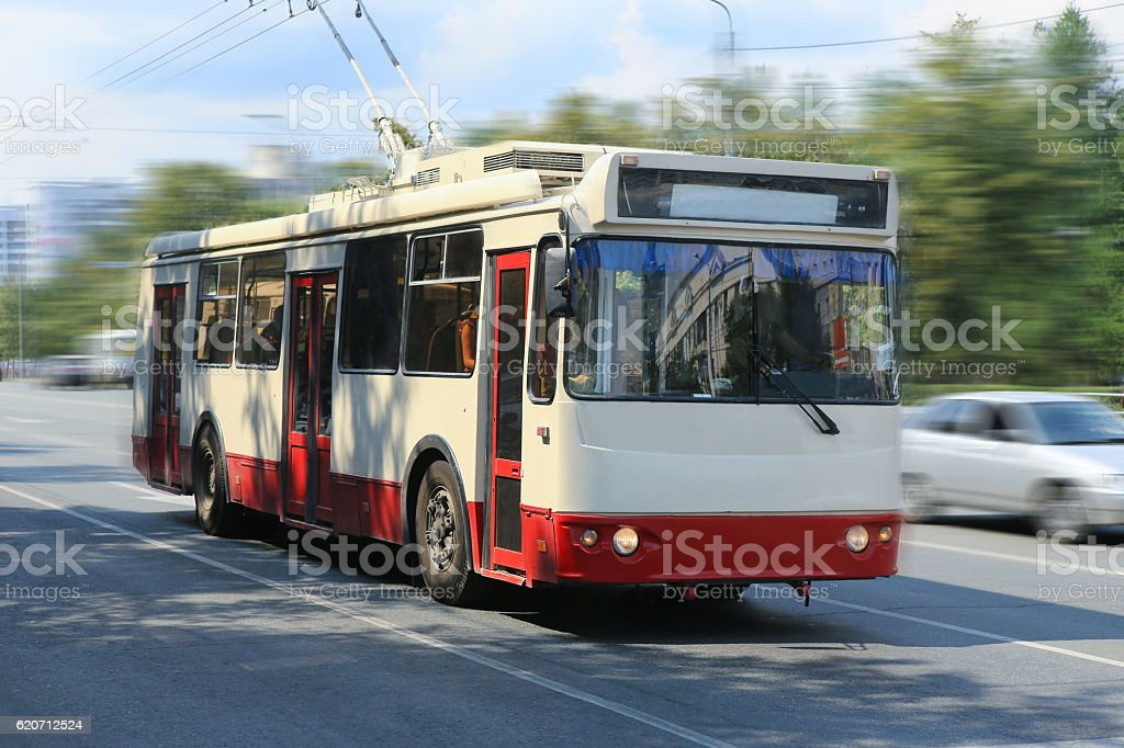 trolleybus going in the city stock photo