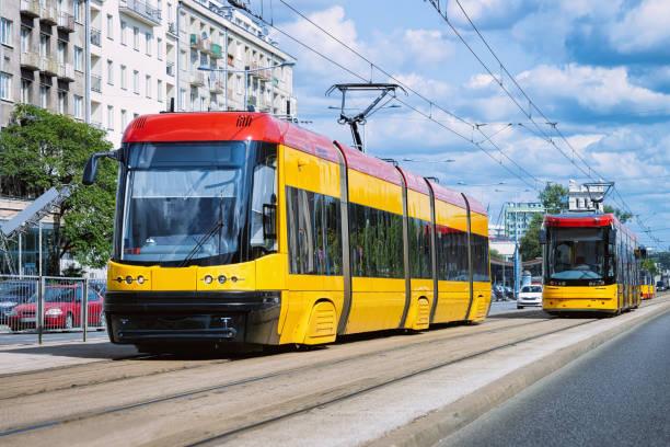 trolleys on road in warsaw city center - linea tranviaria foto e immagini stock
