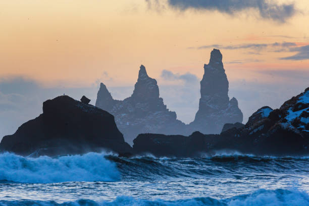 Trolls fingers rock, Iceland winter, Vik village, sunset in Iceland stock photo
