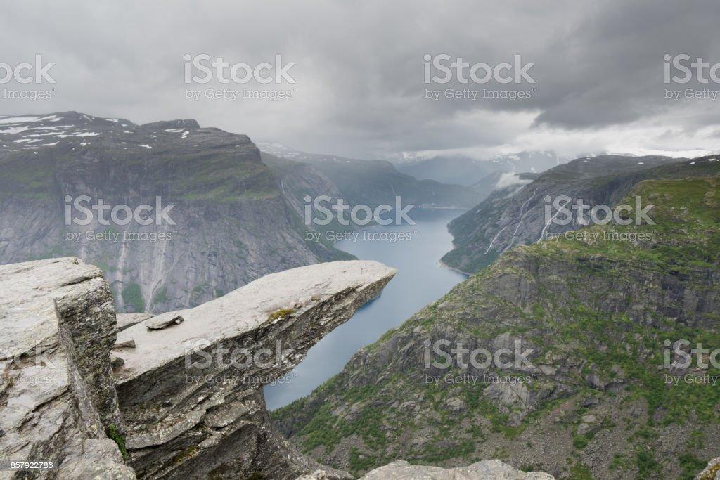 Trolltunga  in cloudy bad weather, Norway stock photo