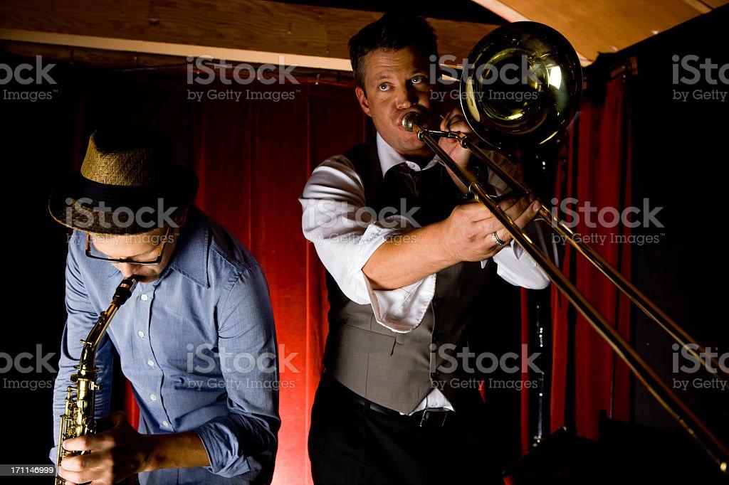 Trombone and Saxophone Player At Bar stock photo