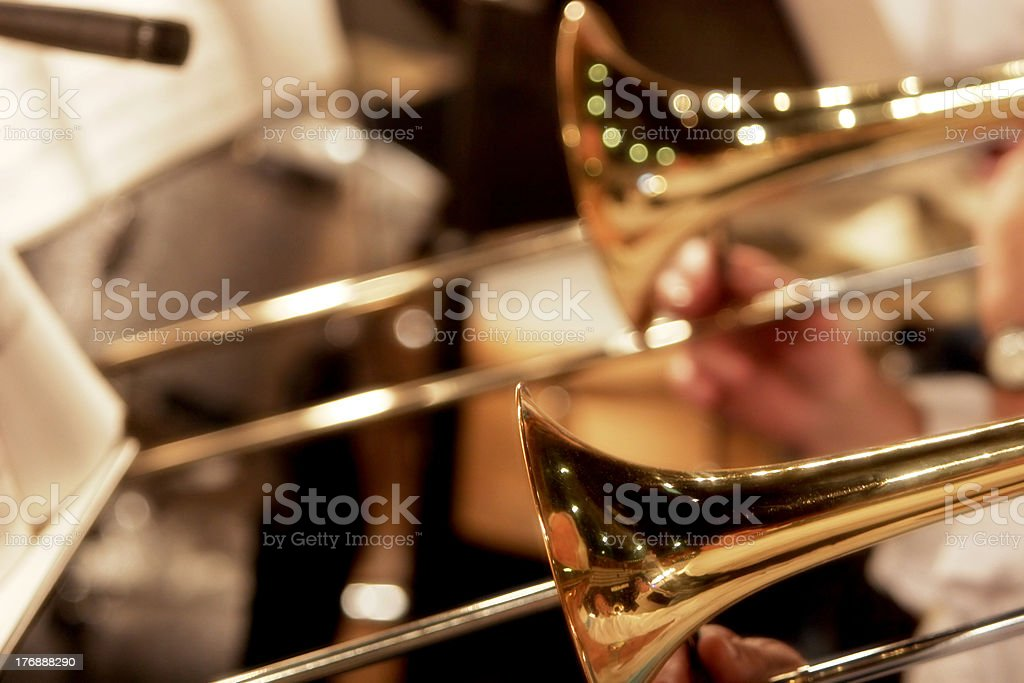 Trombones Playing in a Big Band (shallow focus) royalty-free stock photo