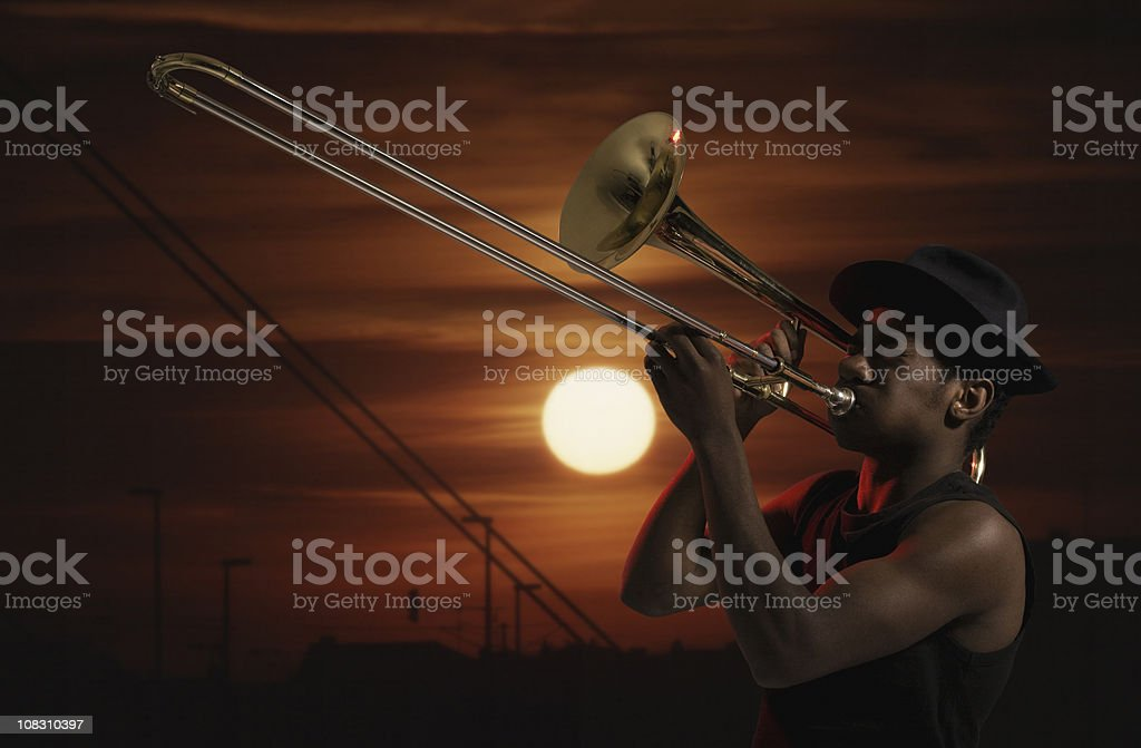 Trombonist at sunset stock photo